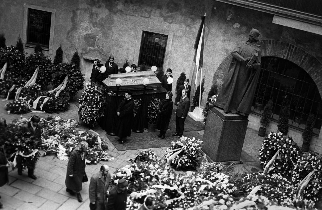 1. The courtyard of the historical Charles University (1347) in Prague. The coffin with PalachÕs body lays next to the the statue of Jan Hus a Czech scholar who was burned by the Catholic Church during the reformation.University dignitaries surround the coffin while people press closer to pay their respects. Palach was buried in PragueÕs OLSANY cemetery, but his grave was visited by such large crowds that the secret police exhumed the body, cremated it and returned the ashes to his mother in the village of Vsetaty, where it was not allowed to be buried until 1974.The grave then became a pilgrimage for dissidents on the anniversary of his death; though each year the secret police arrested people there. Jan Palach was a twenty year old student of Philosophy in Prague when the Russians invaded Czechosolvakia in August 1968.  By January of 1969, he and a group of student friends felt that that nation needed re-awakening' from the fatelistic lethagy that had set in following the invasion. They decided that one of them would set himself on fire as their way of protest.  To choose they picked matches, Jan Palach, as they say in Englished picked the short straw.