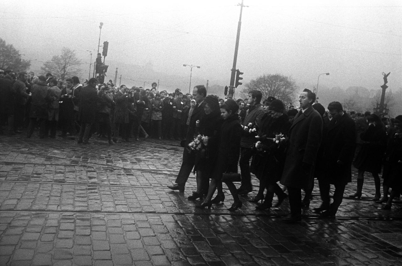 2. Palach's family in the funeral Procession. Palach's mother died in her early 50's killed they say by grief, but also by constant interogation and harassment by the secret police.Jan Palach was a twenty year old student of Philosophy in Prague when the Russians invaded Czechosolvakia in August 1968.  By January of 1969, he and a group of student friends felt that that nation needed re-awakening' from the fatelistic lethagy that had set in following the invasion. They decided that one of them would set himself on fire as their way of protest.  To choose they picked matches, Jan Palach, as they say in Englished picked the short straw.