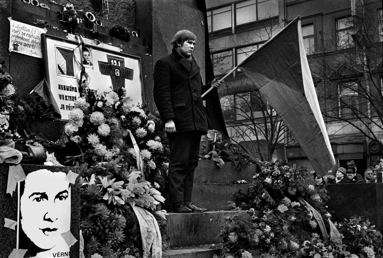 19.  Around the time of his death and during the funeral, there was a vigil by students at the base of Saint WencelavÕs statue in Prague.  People holding black flags and Czech flags, pictures of Palach and messages from foreign students.Jan Palach was a twenty year old student of Philosophy in Prague when the Russians invaded Czechosolvakia in August 1968.  By January of 1969, he and a group of student friends felt that that nation needed re-awakening' from the fatelistic lethagy that had set in following the invasion. They decided that one of them would set himself on fire as their way of protest.  To choose they picked matches, Jan Palach, as they say in Englished picked the short straw.